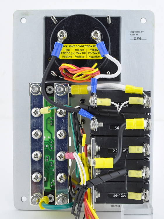 ac and branch traditional flat metal circuit breaker panel with 120 volt voltmeter